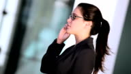 Young Businesswoman Using Cell Phone video