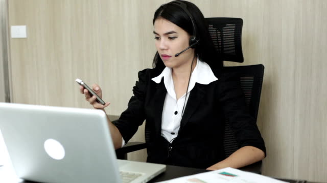 Young businesswoman using  smartphone video