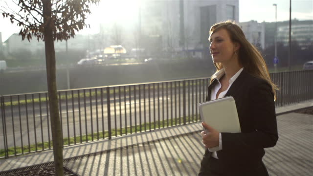 SLOW MOTION: Young businesswoman walking video