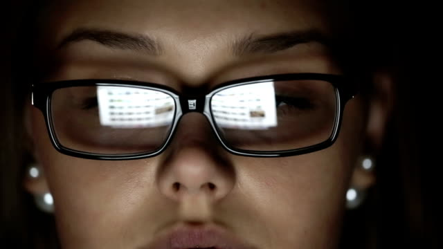 Young businesswoman with glasses who works at night. video