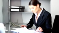 Young businesswoman working at the office. video