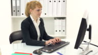 Young businesswoman working in office video