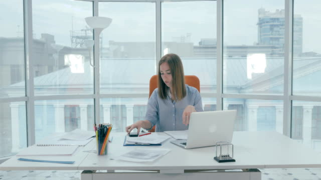 Young businesswoman working on computer in the office video