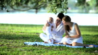 Young Caucasian Parents Baby Outdoors Park video