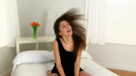 Young Caucasian woman dancing on bed video