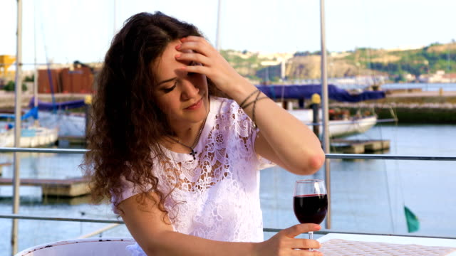 Young Caucasian woman drinking red wine video