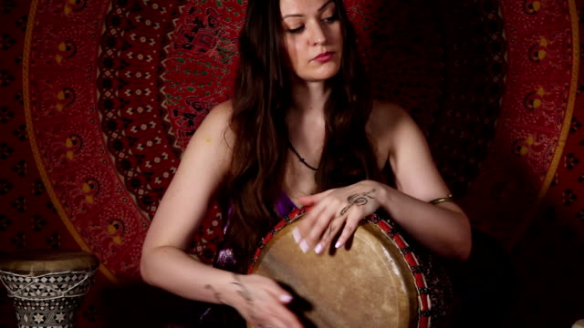 Young Caucasian woman playing the drum video