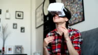Young Caucasian woman playing  using white virtual reality headset glasses video