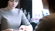 Young caucasian woman receiving a manicure video
