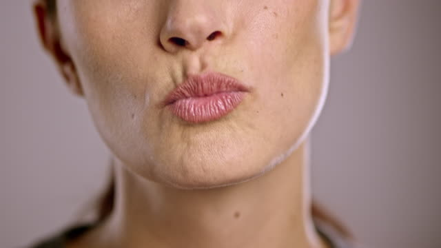 Young Caucasian woman sending a kiss video