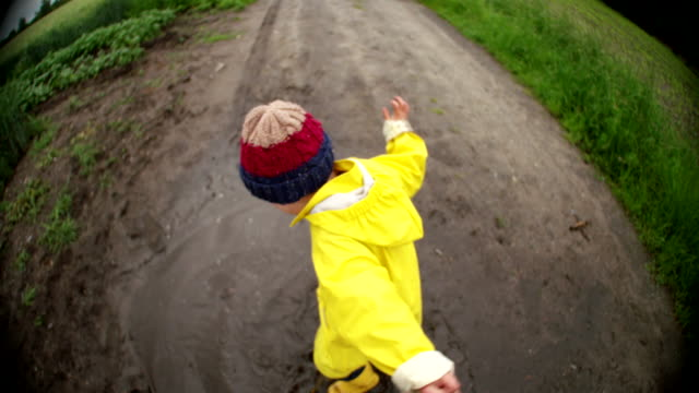 Young Child Jumping In Mud Puddle video