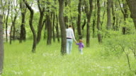 HD Young child playing with her mother in the forest video