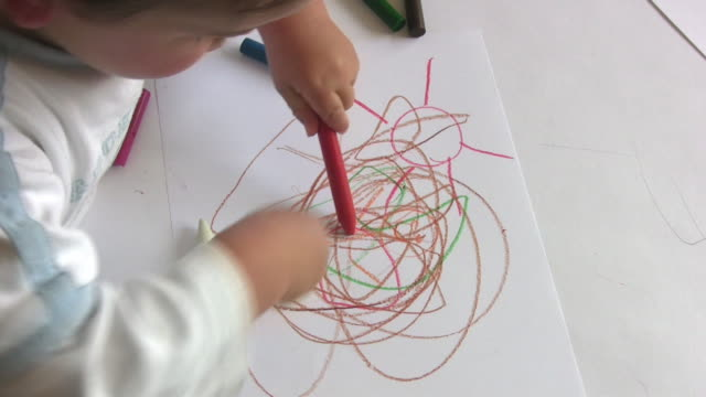 Young child with wax crayons HD video
