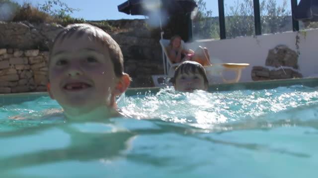 Young children enjoying the summer pool video