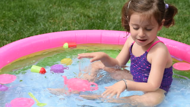 Young children playing in the pool and having fun video