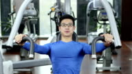 young chinese people work out in modern gym video