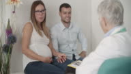Young Couple And Female Doctor In A Consultation. video