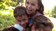 Young couple and kids having fun together outdoors video