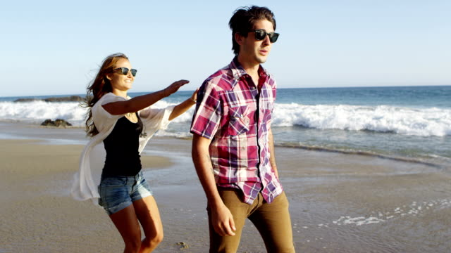 Young couple at beach video