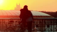 Young couple at sunset in the city video