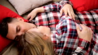 young couple boy and girl in checkered shirts video
