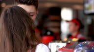 Young couple buy fastfood at the fastfood restaurant video