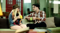 Young Couple Chatting And Drinking Coffee video
