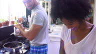 Young Couple Cooking Breakfast In Kitchen Together video