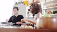 Young couple cooking together video