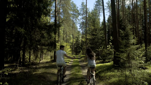 Young Couple Cycling In Nature video
