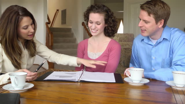 Young Couple Discuss Finances with Female Professional video