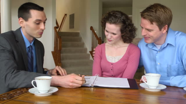 Young Couple Discuss Finances with Male Professional video