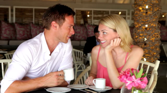 Young Couple Drinking Coffee In Restaurant video