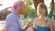 young couple drinking red wine in a romantic place in Rome video