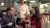 MS TU  Young couple drinking wine in restaurant video