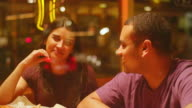A young couple eating at a downtown pizzeria video