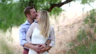 Young couple embrace in vineyard, spring video