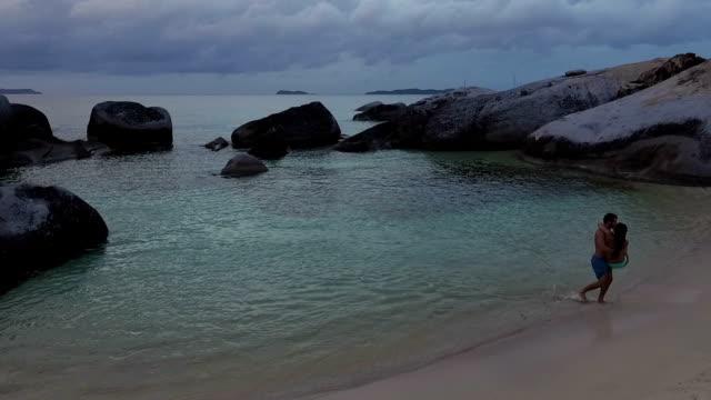 Young couple embracing at tropical beach, Virgin Gorda video