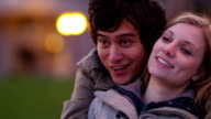 Young couple enjoy city lights at night video