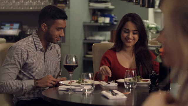 MS Young couple enjoying food in restaurant video