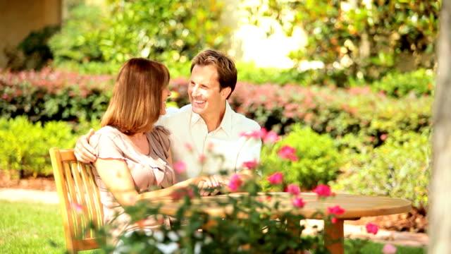 Young Couple Enjoying Garden in Summer video
