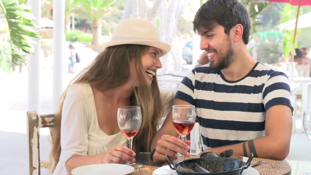 Young Couple Enjoying Meal In Outdoor Restaurant video