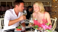 Young Couple Enjoying Meal In Restaurant video