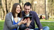 Young couple enjoying outdoor video
