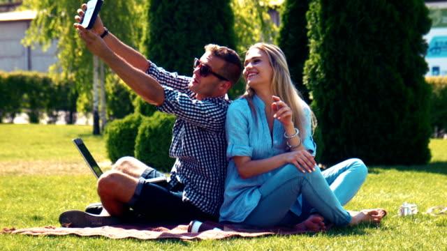 Young couple enjoying the summer sunshine video