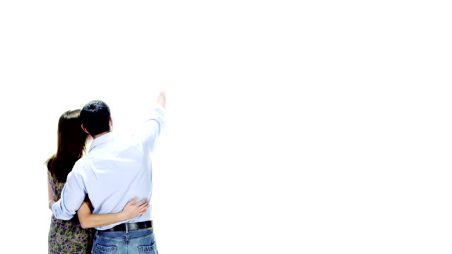 Young couple enjoying themselves on white background video