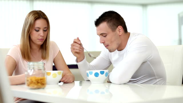 Young couple having breakfast video