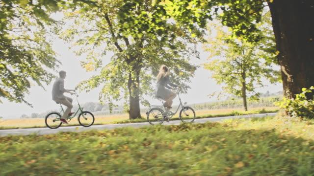 TS Young couple having fun cycling in countryside video