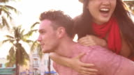 Young Couple Having Fun In Park Together video