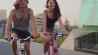Young couple having fun on bicycle ride video